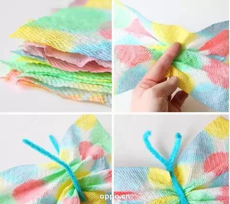 等纸巾完全干透以后,沿着纸巾的中线折几下,取一根扭扭棒绕着中线扭